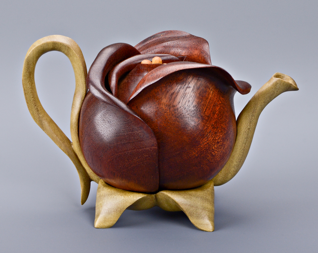 Teapot sculptures carved in wood purses and nature